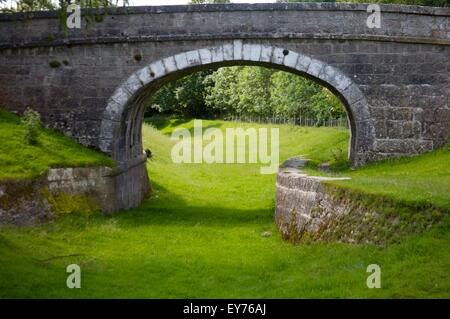A bridge on the disused section of the Lancaster Canal, Cumbria known as 'the northern reaches' of the canal - Stock Photo