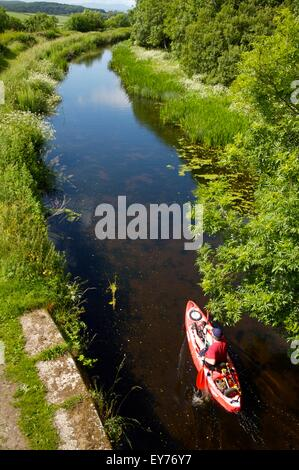 kayaking on 'Northern Reaches' of Lancaster Canal, Cumbria - Stock Photo