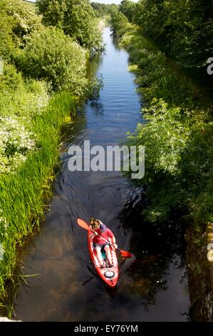 kayaking on Northern Reaches of Lancashire Canal on Lancashire-Cumbria border where not navigable by narrowboat - Stock Photo
