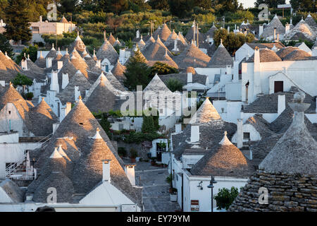 The typical conical stone roofs of trulli houses at Alberobello, Puglia, Italy. - Stock Photo