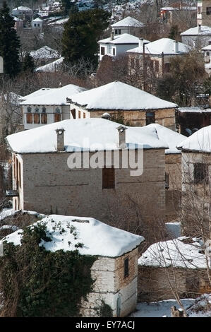 Snow covered roofs in the mountain village of Pinakates on Pelion Peninsula, Thessaly, Greece - Stock Photo