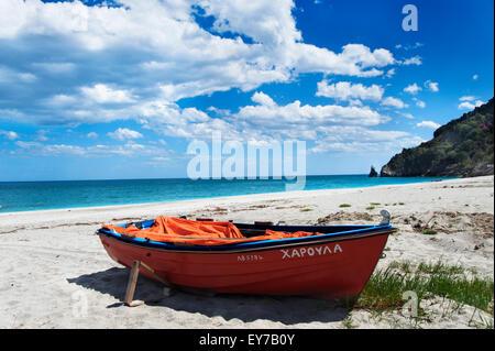 Boat lying on lonely beach on Pelion Peninsula, Thessaly, Greece - Stock Photo