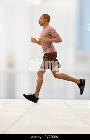 Mid adult man running - Stock Photo