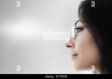 Young woman wearing spectacles - Stock Photo