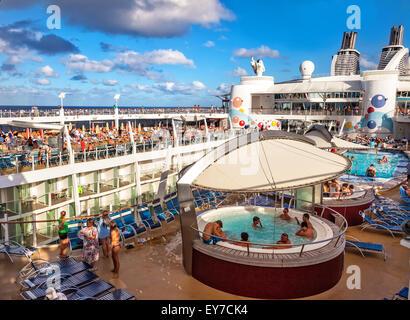 Caribbean Sea - Jan. 17, 2013: Passengers aboard Royal Caribbean's Oasis of the Seas enjoy the pool and sun on the - Stock Photo