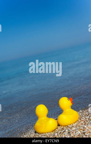 Two rubber duckies on Aegean shores - Stock Photo