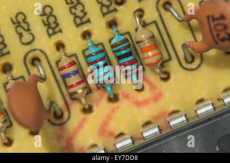 Macro-photo of resistors (carbon, and metal film [blue]), and capacitors on a printed circuit board (PCB). Resistance - Stock Photo