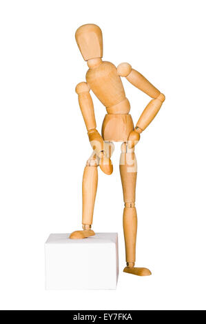 Wooden mannequin lean on the box. - Stock Photo