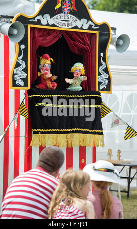 People watching a Punch and Judy Show at the Thames Traditional Boat Festival, Fawley Meadows, Henley On Thames, - Stock Photo