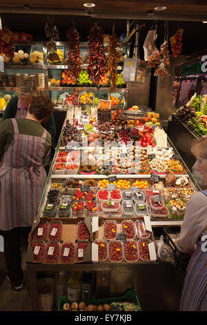 Stall with fruits and mushrooms in La Boqueria food market in Barcelona, Catalonia, Spain - Stock Photo
