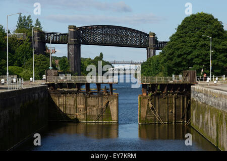 Latchford Locks and the disused Latchford Railway Viaduct crossing the Manchester Ship Canal in Latchford Warrington - Stock Photo