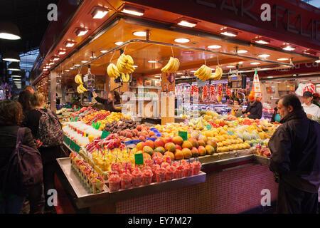 Fresh fruits in La Boqueria food market in Barcelona, Catalonia, Spain - Stock Photo