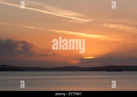 Sunrise over Falmouth Bay in Cornwall, England - Stock Photo