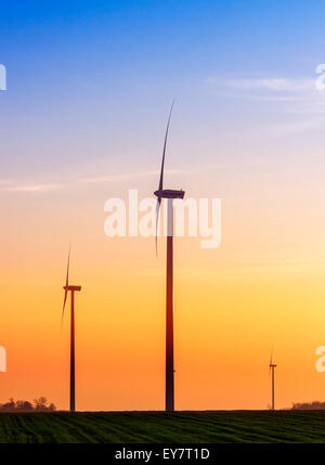 Alternative energy concept, windmills at sunset. - Stock Photo