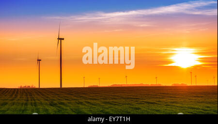 Renewable energy concept, windmills at sunset. - Stock Photo