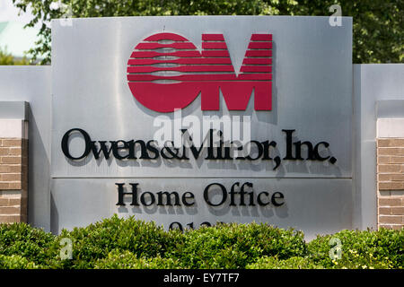 A logo sign outside of the headquarters of Owens & Minor Inc., in Mechanicsville, Virginia on July 19, 2015. - Stock Photo