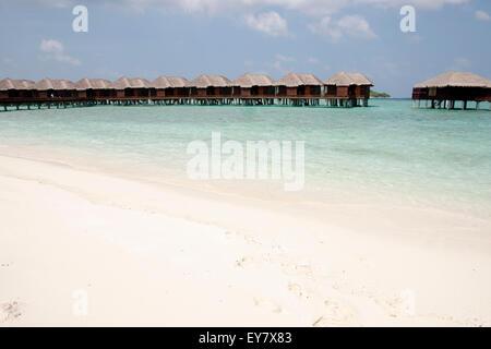 Lagoon Huts - Maldives - Stock Photo