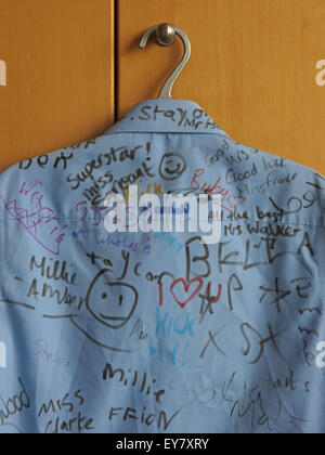 School Leavers Shirt with signatures of classmates - Stock Photo