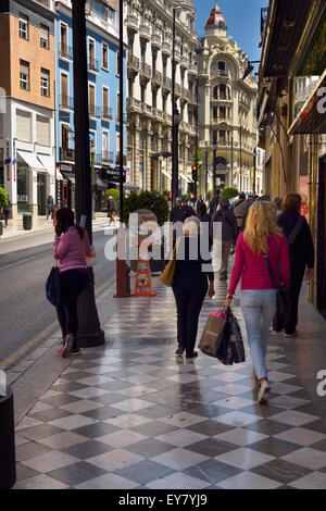 Pedestrians on the marble sidewalk of Catholic Kings street Granada Spain - Stock Photo