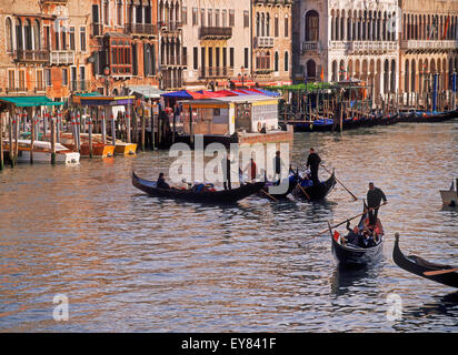 Gondolas on Grand Canal in Venice at sunset - Stock Photo