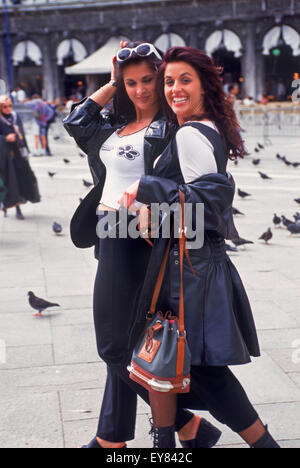 People and pigeons on Piazza San Marco or St. Marks Square in Venice Italy - Stock Photo