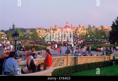 Euro Disneyland or Eurodisney at Euro Disney Resort near Paris with Main Street tourist and shops and bus in sunset - Stock Photo