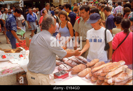 Open air markets and restaurants on Place de la Liberte at Old Town of Sarlat  in Dordogne France - Stock Photo