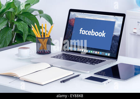 Varna, Bulgaria - May 29, 2015: Facebook new logo on Apple MacBook Pro with open tab in Safari browser that is on - Stock Photo