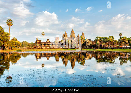 Cambodian landmark Angkor Wat with reflection in water on sunset. Siem Reap, Cambodia - Stock Photo