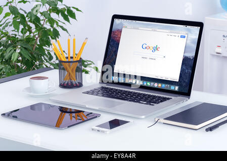 Varna, Bulgaria - May 29, 2015: Apple MacBook Pro Retina with Safari browser which shows Google search with iPad - Stock Photo