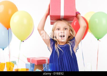 Cheerful girl holding present box - Stock Photo