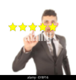 Young man with five stars isolated on white background - Stock Photo