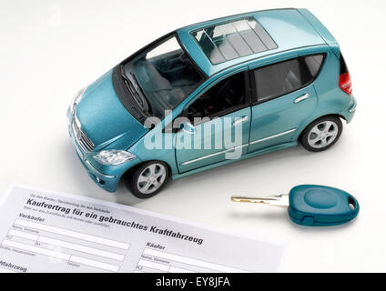 Car with key and purchase agreement for a used vehicle. - Stock Photo
