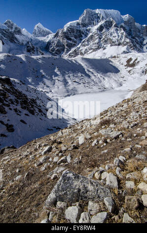 Trekkers on the Larke La Pass of the Manaslu Circuit trek in Nepal - Stock Photo
