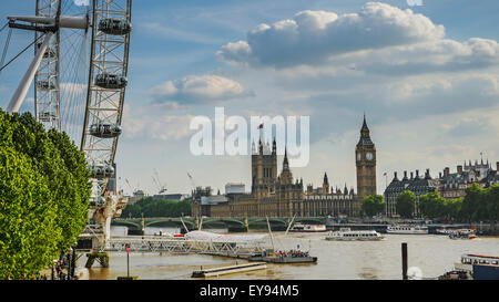 London Eye, Big Ben and Houses of Parliament in London City at sunset - Stock Photo