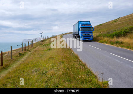 heavy goods vehicle articulated lorry traveling along the military road at afton down near freshwater isle of wight - Stock Photo
