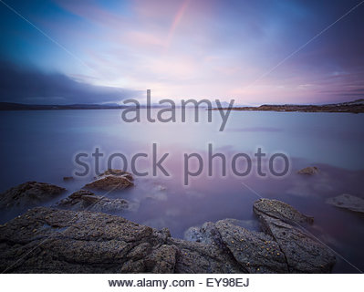 Irish seascape with rainbow out over the sea; County Galway, Ireland - Stock Photo