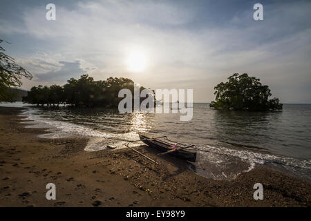 Boat and mangroves in Areia Branca; Dili, East Timor - Stock Photo