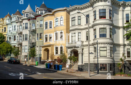 Beautiful Victorian Buildings some with turrets, adorn a San Francisco Street , California , USA - Stock Photo