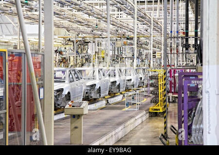 cars in a row at car plant - Stock Photo
