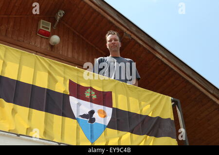 Kenneth Lillieholm, Grounds Operation Manager of LSA (Liberland Settlement Association) on the balcony of one of - Stock Photo