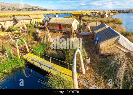 View of man made floating islands on Lake Titicaca near Puno, Peru - Stock Photo
