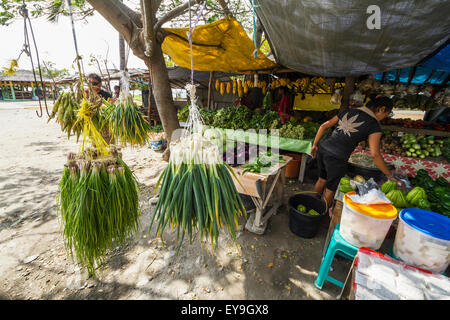 Vendor and produce for sale at the market; Dili, East Timor - Stock Photo