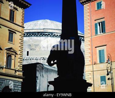Obelisk Of Santa Maria Sopra Minerva With Pantheon In Background - Stock Photo