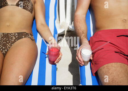 Young Couple Drinking Cocktails On Sunloungers At Beach,Mid Section, Mayan Riviera,Yucatan Peninsular,Quintana Roo - Stock Photo