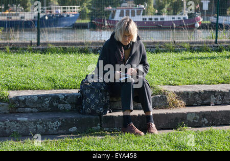 Saverne, France, a tourist reading a Reisefueher - Stock Photo