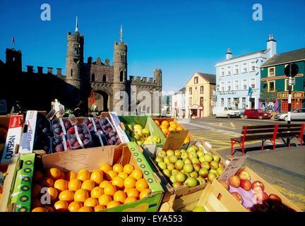 Macroom, County Cork, Ireland; Outdoor Market With Castle - Stock Photo