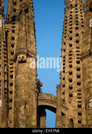 Two Towers Of A Building With A Walkway Connecting Them Against A Blue Sky - Stock Photo