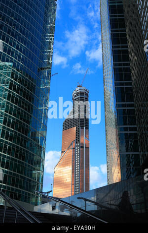 Contemporary skyscrapers and construction site in financial district. - Stock Photo
