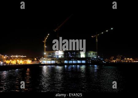 A construction site at night in the Caspian seacoast promenade in the city of Baku capital of Azerbaijan - Stock Photo